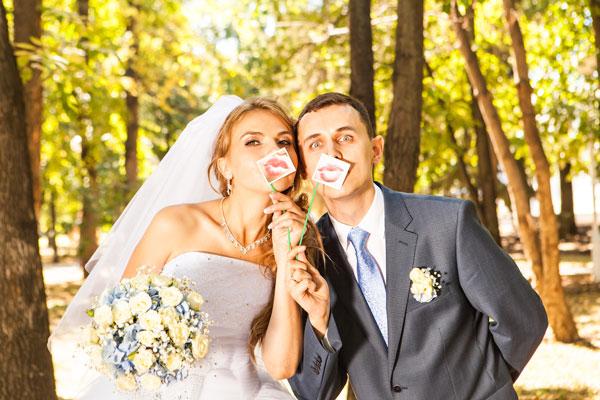 Wedding couple posing with stick lips